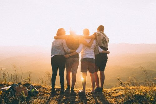 group of friends at sunset